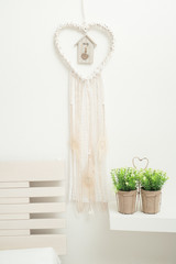 Dream catcher with beige feathers