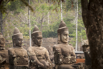 Asura Guardians heads in the bridge on the South Gate of Angkor Thom. Siem Reap, Cambodia