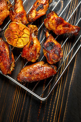 Grilled chicken wings on the grill