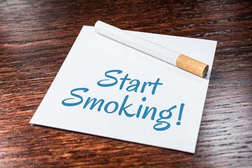 Start Smoking Reminder With Cigarette On Wooden Shelf