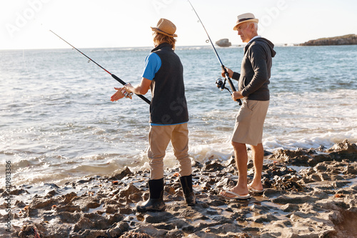 Senior man fishing with his grandson stock photo and for Senior fishing license