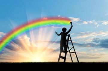 Photo sur Aluminium Bleu jean Child paints a rainbow in the sky