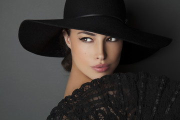 woman with black hat