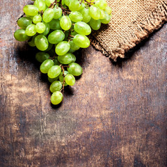 White  grapes bunch over wooden  background. Green grape, countr