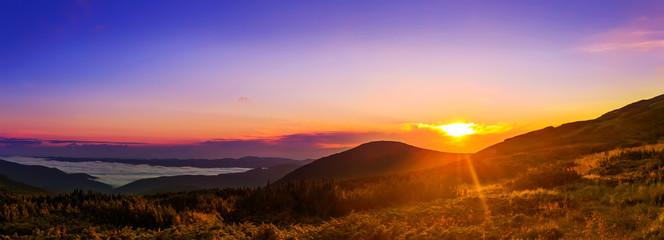 Picturesque sunrise, morning dawn in Carpathian mountains, panorama, Ukraine.