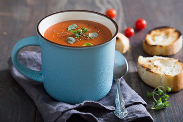 Tomato soup with herbs in a mug