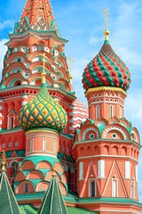 Fototapete - The most famous architectural place for visiting and attraction in Moscow, Russia, Saint Basil's cathedral with colorful cupolas and spectacular domes in traditional culture on cloudy blue sky