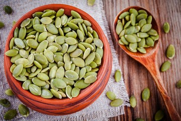 organic pumpkin seeds in a clay bowl