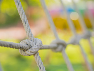 Rope tied in a knot, Children in playground.