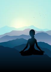Woman meditating on the mountain