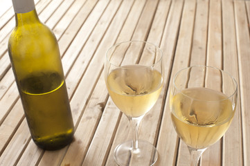 Glasses of white wine and a bottle