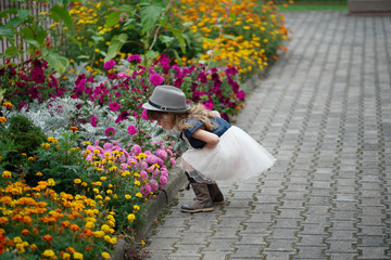 beautiful girl in flowers park