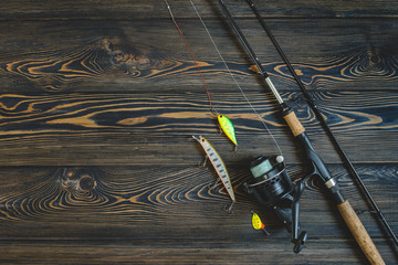 fishing tackle on a wooden table. toned image. place for the text