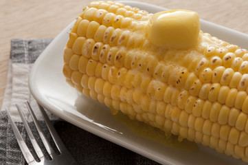 Cooked corn-cob with butter on top