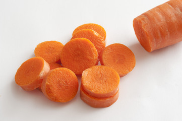 Chopped carrot on white table