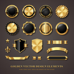 collection of black and golden design elements - shields, labels, seals, banners, badges, scrolls and ornaments
