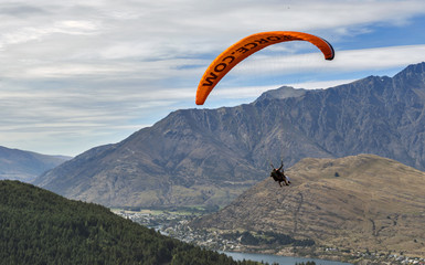 Tandem paragliding over Lake Wakatipu in Queenstown, New Zealand