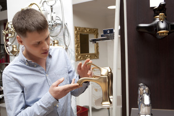 Man shopping for bathroom equipment in store