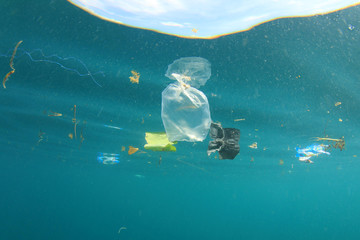Plastic pollution. Environmental problem. Plastic trash bags in sea.
