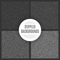 Set of black and white grainy dotwork textures. Retro halftone stippled backgrounds.