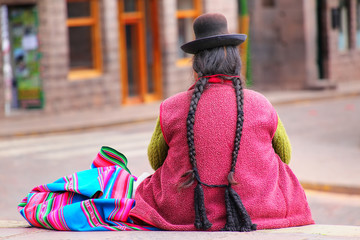 Local woman sitting at Plaza de Armas in Cusco, Peru