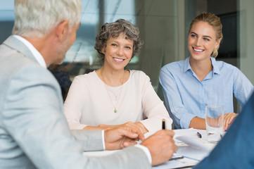 Senior businesswoman in a metting