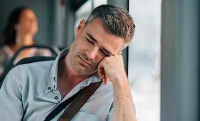 Man sleeping on the bus