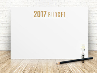 2017 budget year text on white paper poster with black pencil an