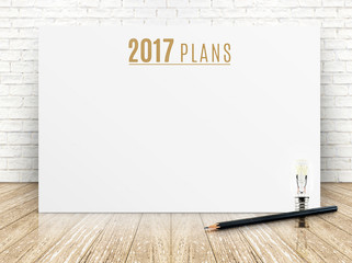2017 plans year text on white paper poster with black pencil and