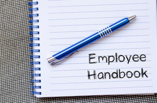 Employee handbook text concept on notebook