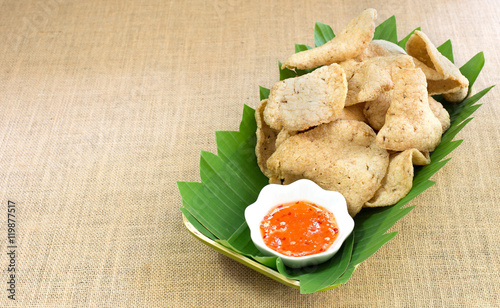 """""""Fish crackers with spicy and sweet sauce in banana leaf ..."""