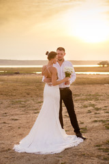 Couple in the sunset light wedding photo