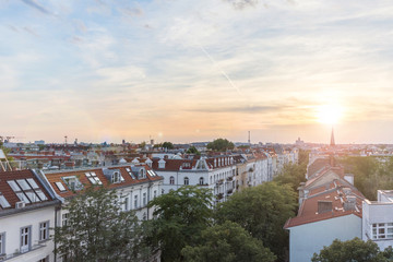 View over rooftops , city skyline at sunset