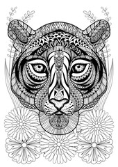 Zentangle stylized tiger face on flowers. Hand drawn ethnic anim