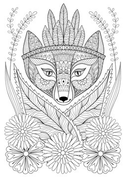 Zentangle wild fox with indian war bonnet in grass and flowers.