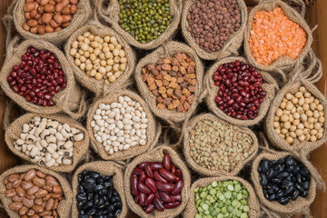 Various colorful dried legumes in sackcloth  for background