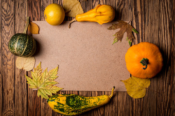 Autumn background on wooden boards. Space for text.