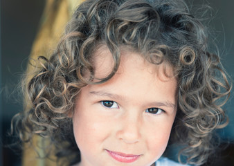 Portrait of girl with curly hair