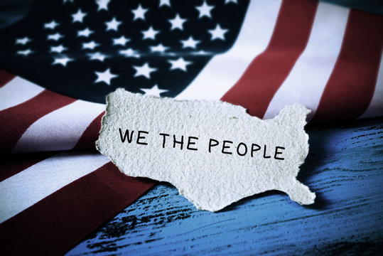 text we the people and flag of USA