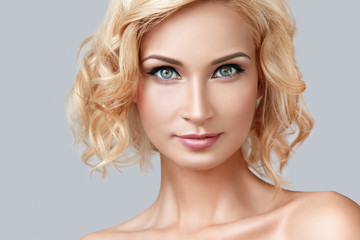 Beautiful blonde woman with eyeliner on her eyes