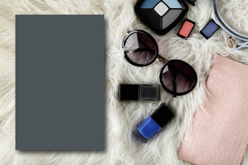 Colorful cosmetics and sunglasses on white background. Beauty and makeup concept. Space for text.