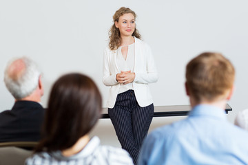 Portrait of Female Businesswoman Listening to Question at Confer