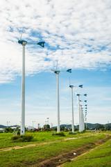 Wind turbine with sky cloud sun daylight