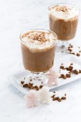 festive spiced pumpkin latte and almond cookies, vertical