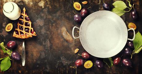 Plum tart and fresh plums