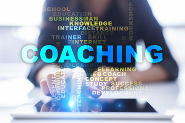Coaching words cloud. Woman using tablet pc and pressing button.