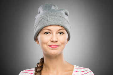 Attractive young woman in winter hat