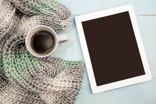 Cosy soft winter background, knitted sweater tablet Cup hot coffee old vintage wooden board. Christmas holidays at home. place for text, Top view, flat lay with copy space  slogan or  message
