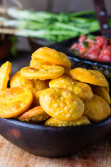 Latin American food. Traditional chilenian homemade pumpkin sopaipillas with salsa