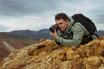Man photographer camera mountains concept